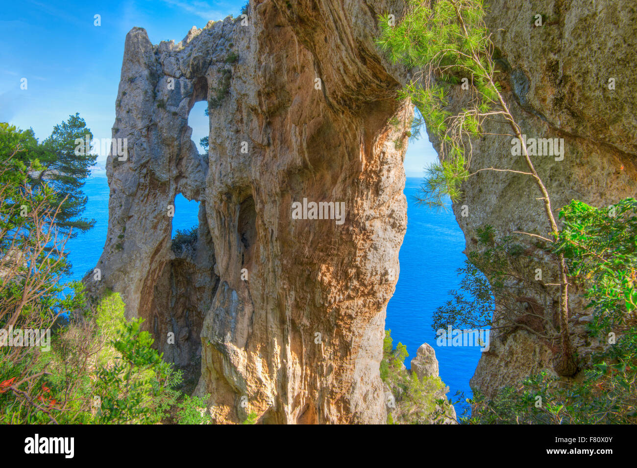 The Arch, quadriple natural arch on cliffs above Capri and Tyrrhenian Sea, Italy - Stock Image
