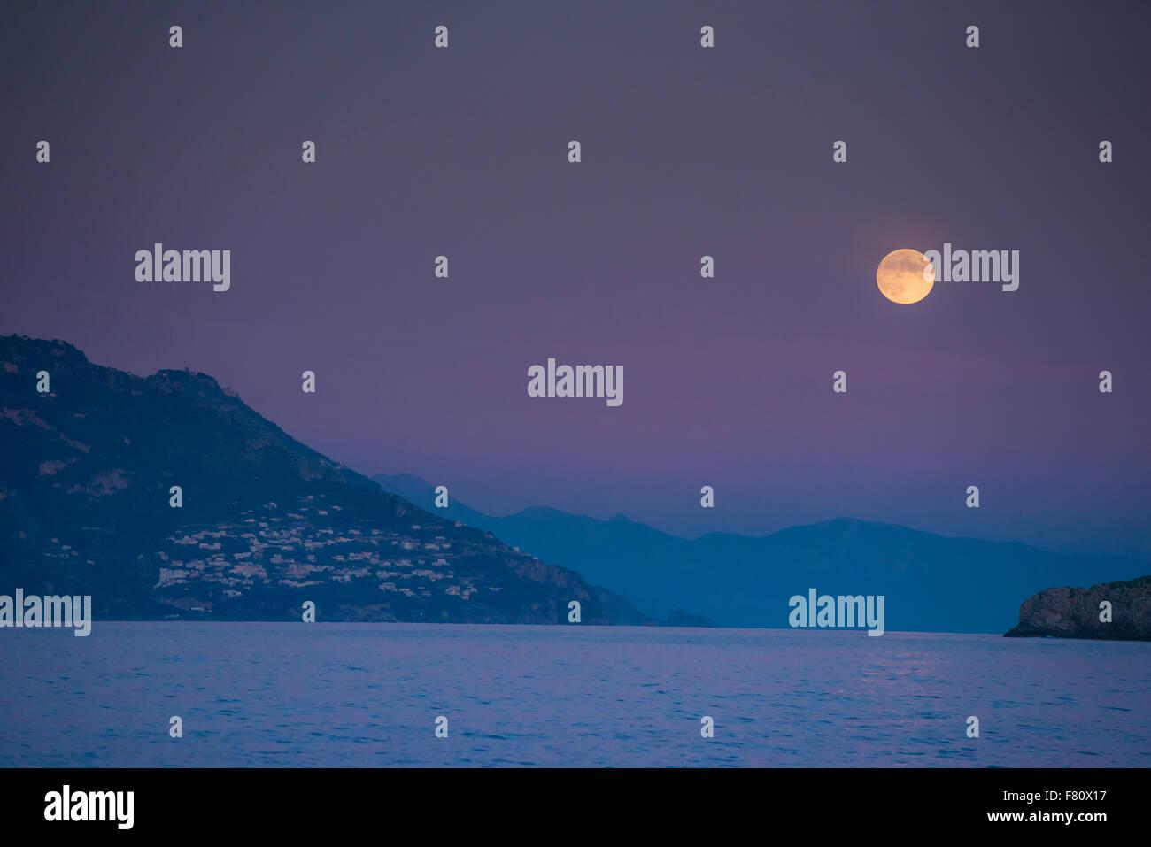 Moonrise over Amalfi Coast. Italy, Gulf of Salerno adn Tyrrhenian Sea - Stock Image