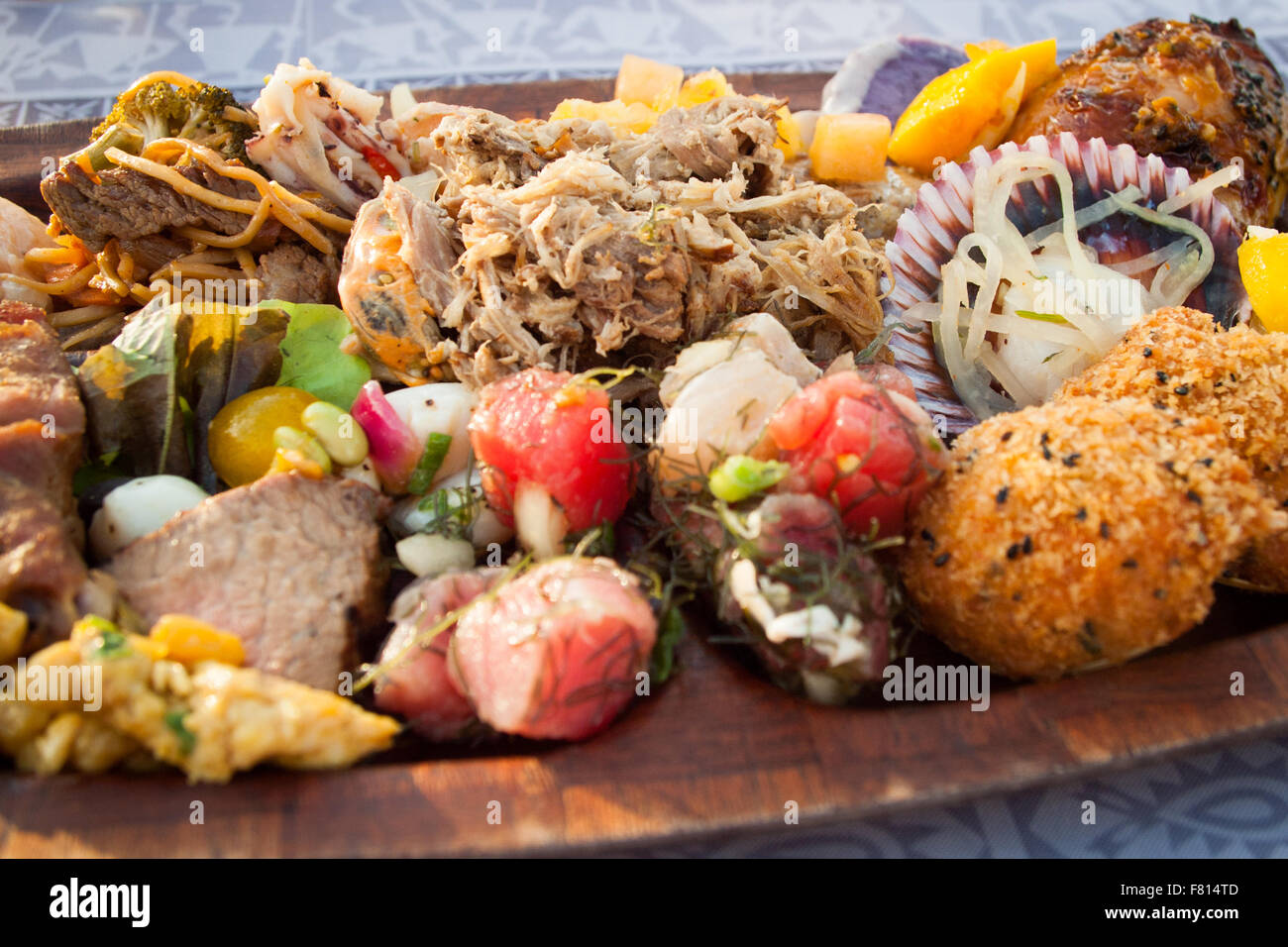 Delicious food from the Polynesian buffet at the Gathering of Kings Hawaiian lu'au. Fairmont Orchid, Kohala - Stock Image