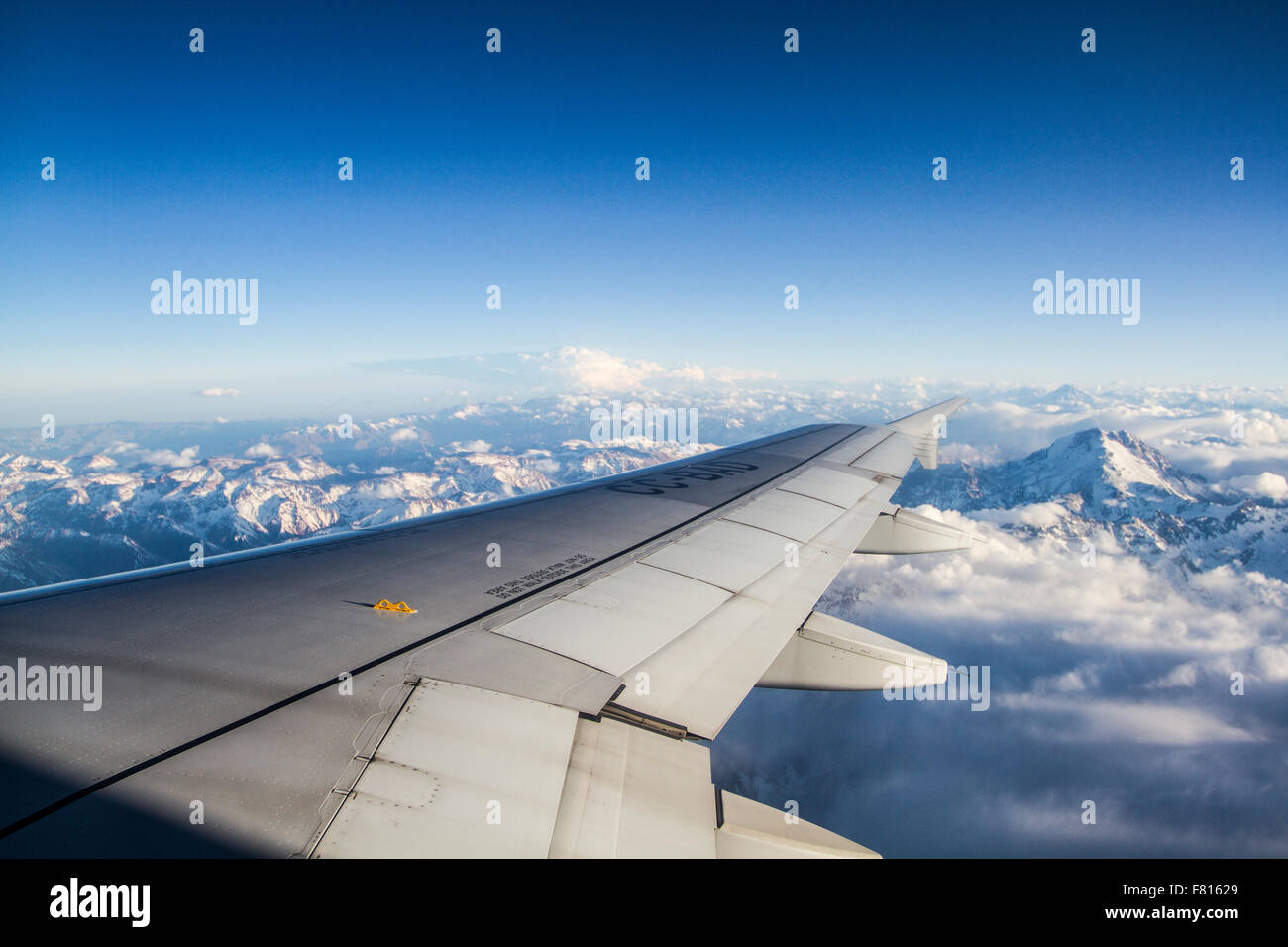 Andes Mountains (Cordillera de los Andes) viewed from an airplane window, near Santiago, Chile. - Stock Image