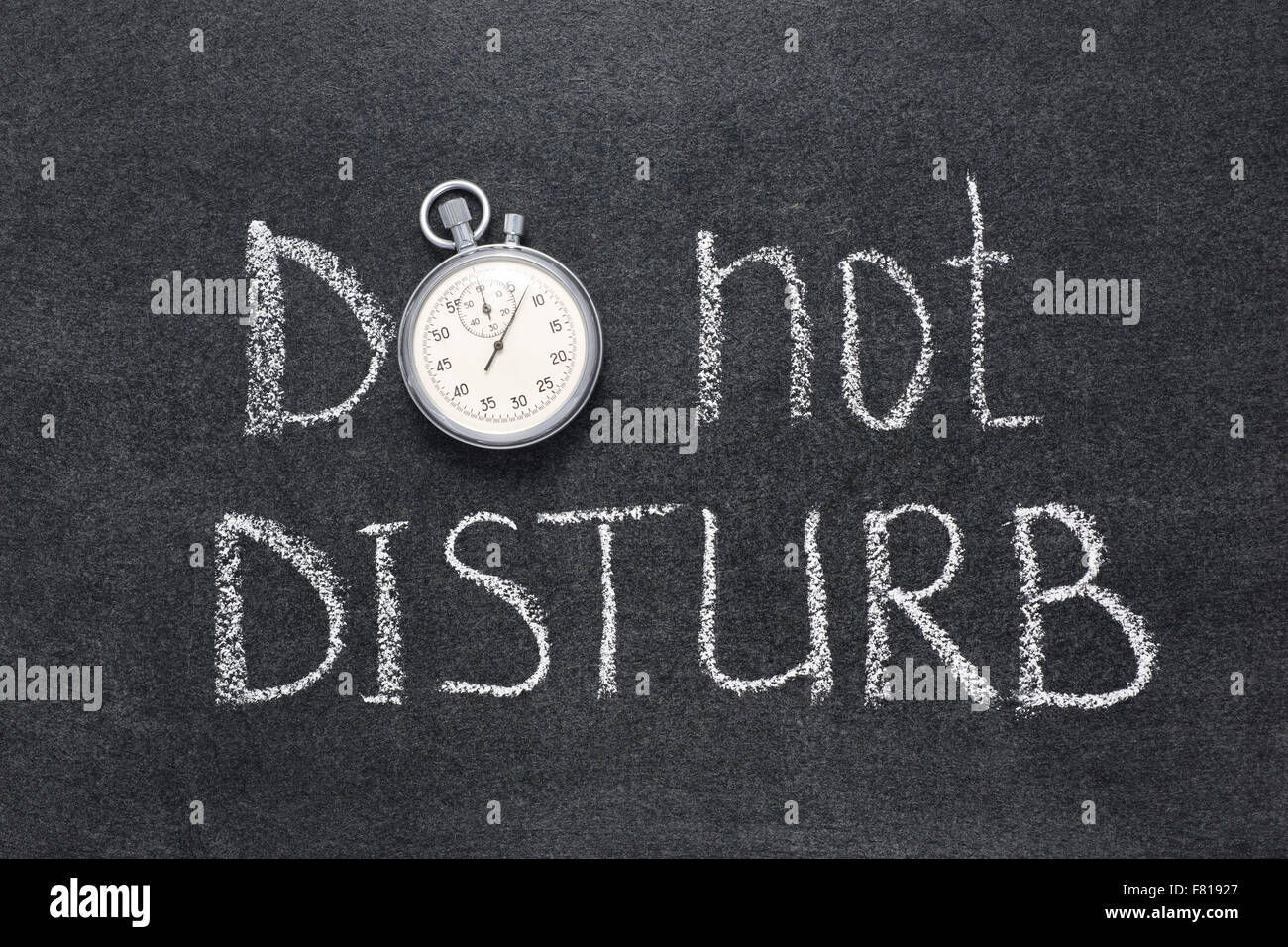 do not disturb request handwritten on chalkboard with vintage precise stopwatch used instead of O - Stock Image