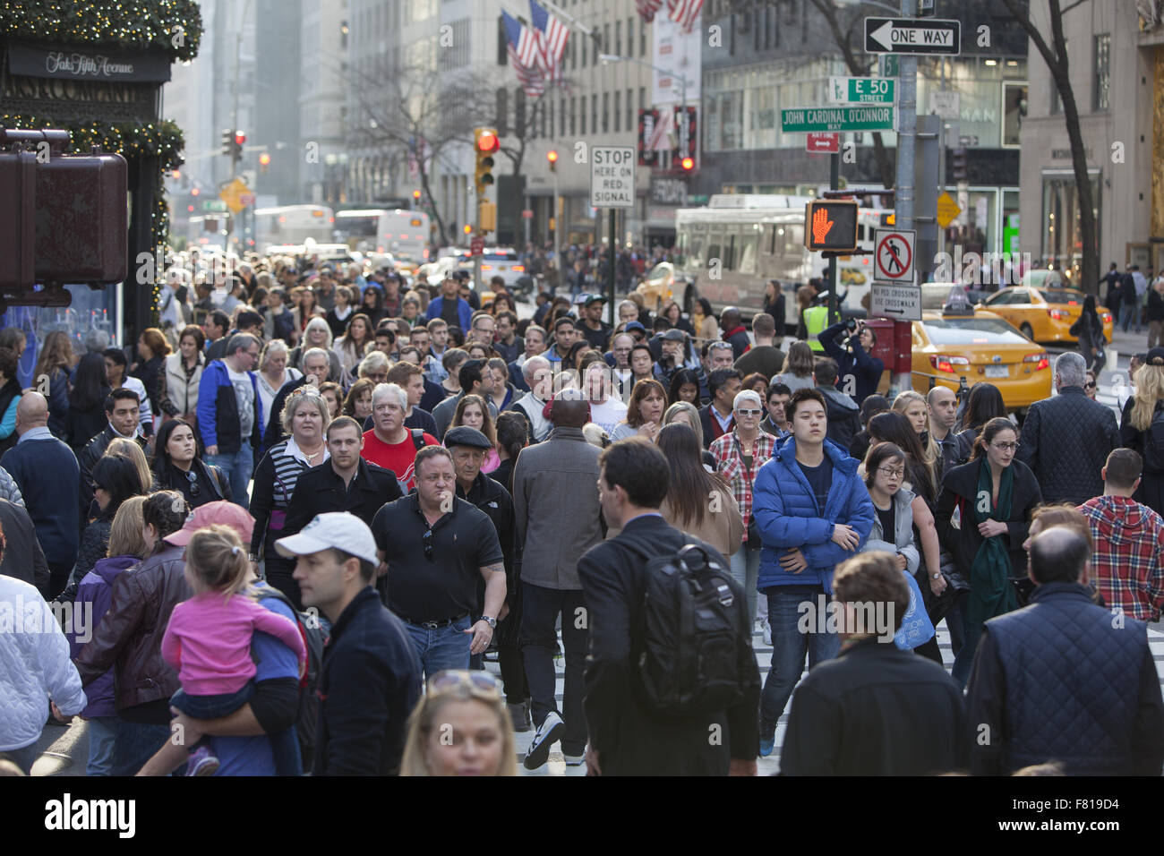 On Black Friday the busiest shopping day the street crowds are enormous on 5th Avenue near Rockefeller Center in - Stock Image