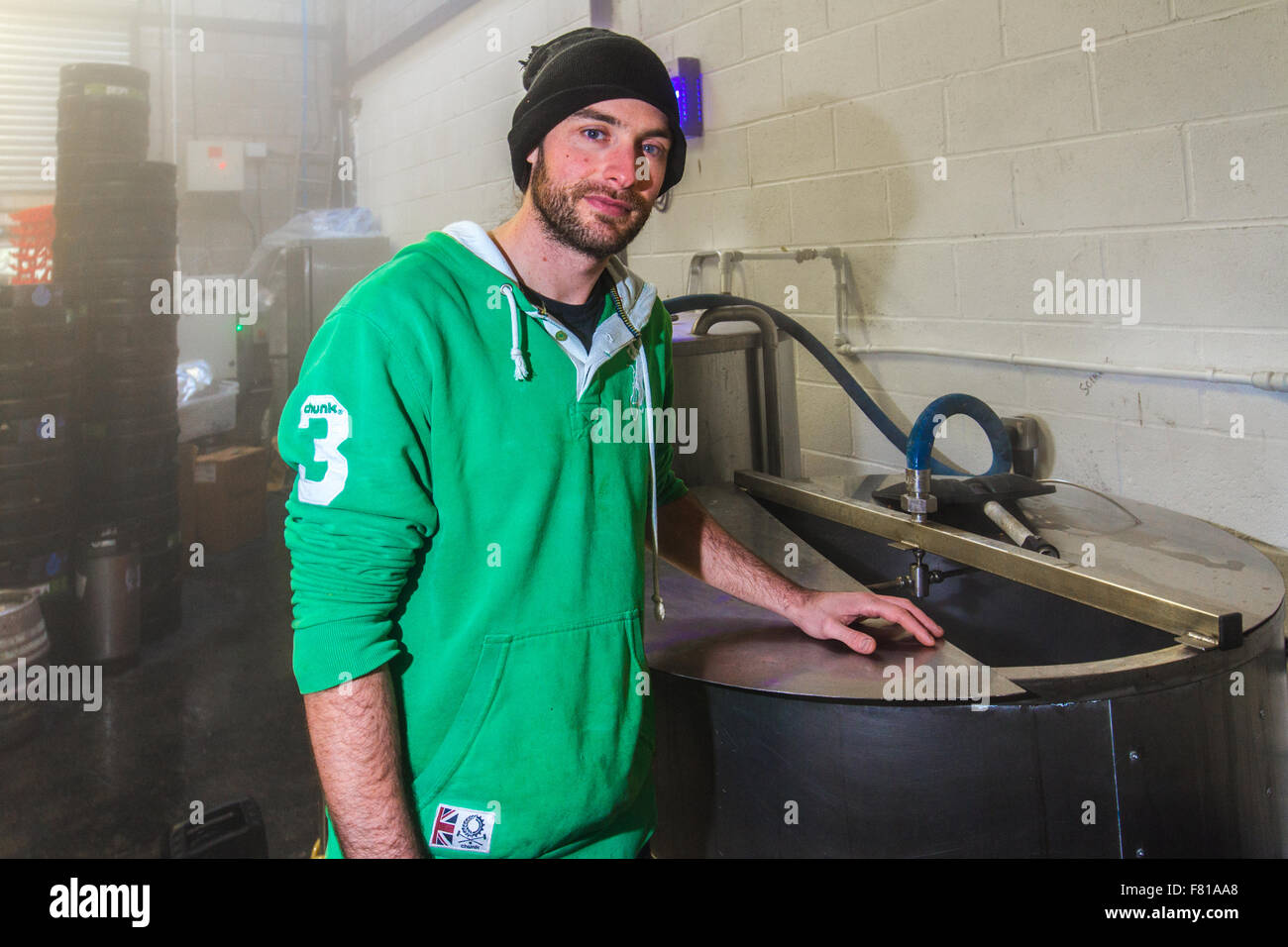 Cardiff, United Kingdom, November 26 2015. Brewer Adam stands by brewing equipment at the Crafty Devil Microbrewery, - Stock Image