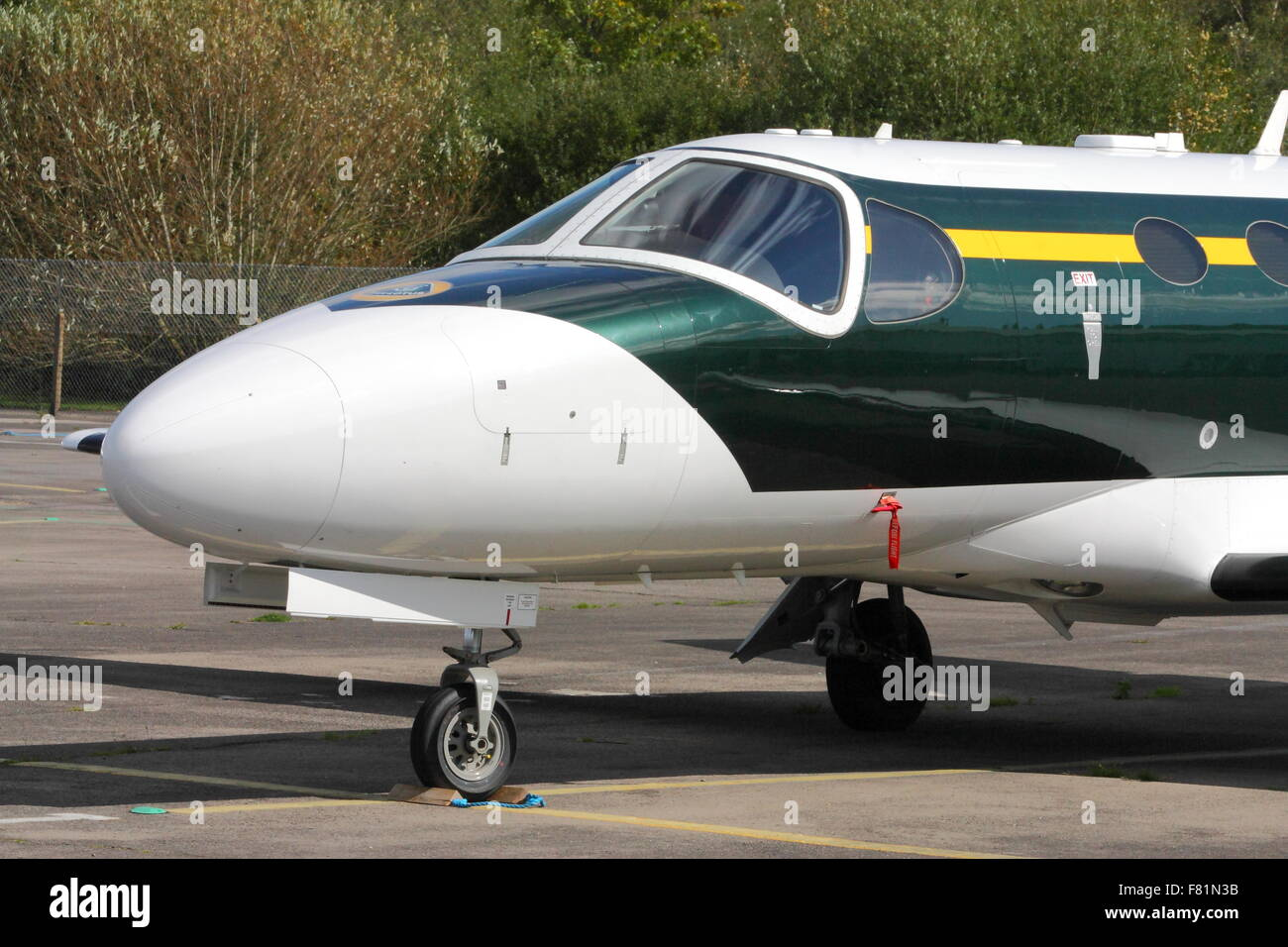 Cessna 510 Citation Mustang of Team Lotus parked at Blackbushe Airport - Stock Image