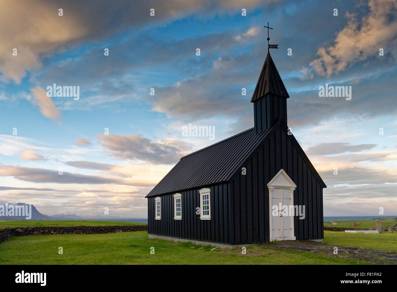 The famous black church at Budir on the Snaefellsnes Peninsula in Iceland. - Stock Image