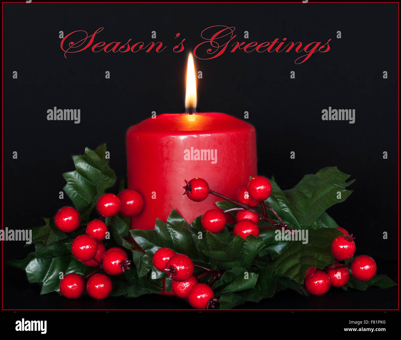 Seasons  Greetings card with red candle and holly branches. - Stock Image