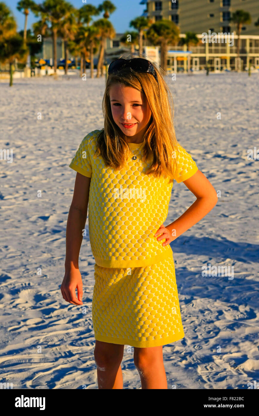 Young pre-teen girl posing in front of the camera on Siesta Key beach in Florida Stock Photo