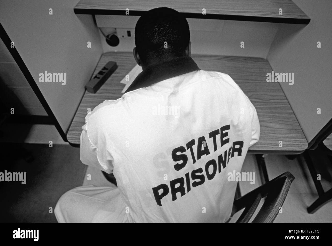 State Prisoners study English textbooks at a correctional facility in Georgia. - Stock Image