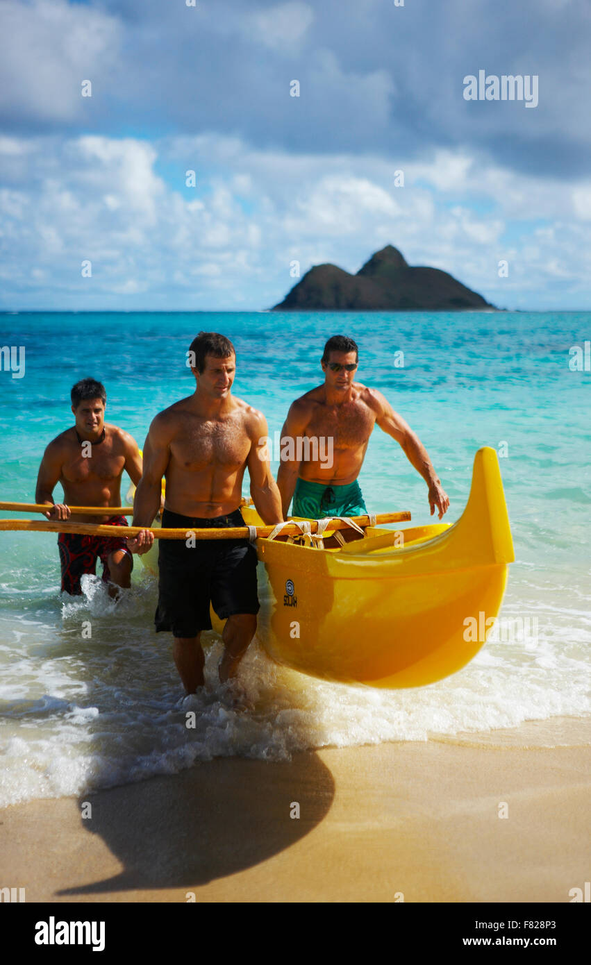 Three outrigger canoers - Stock Image