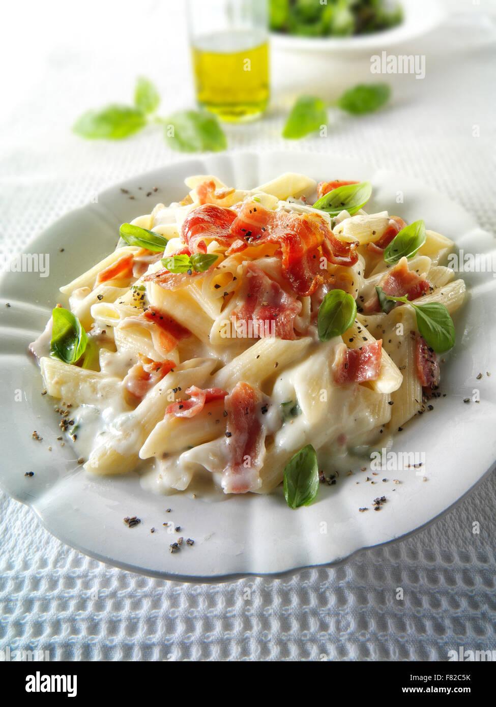 Pene bacon carbonara recipe meal - Stock Image