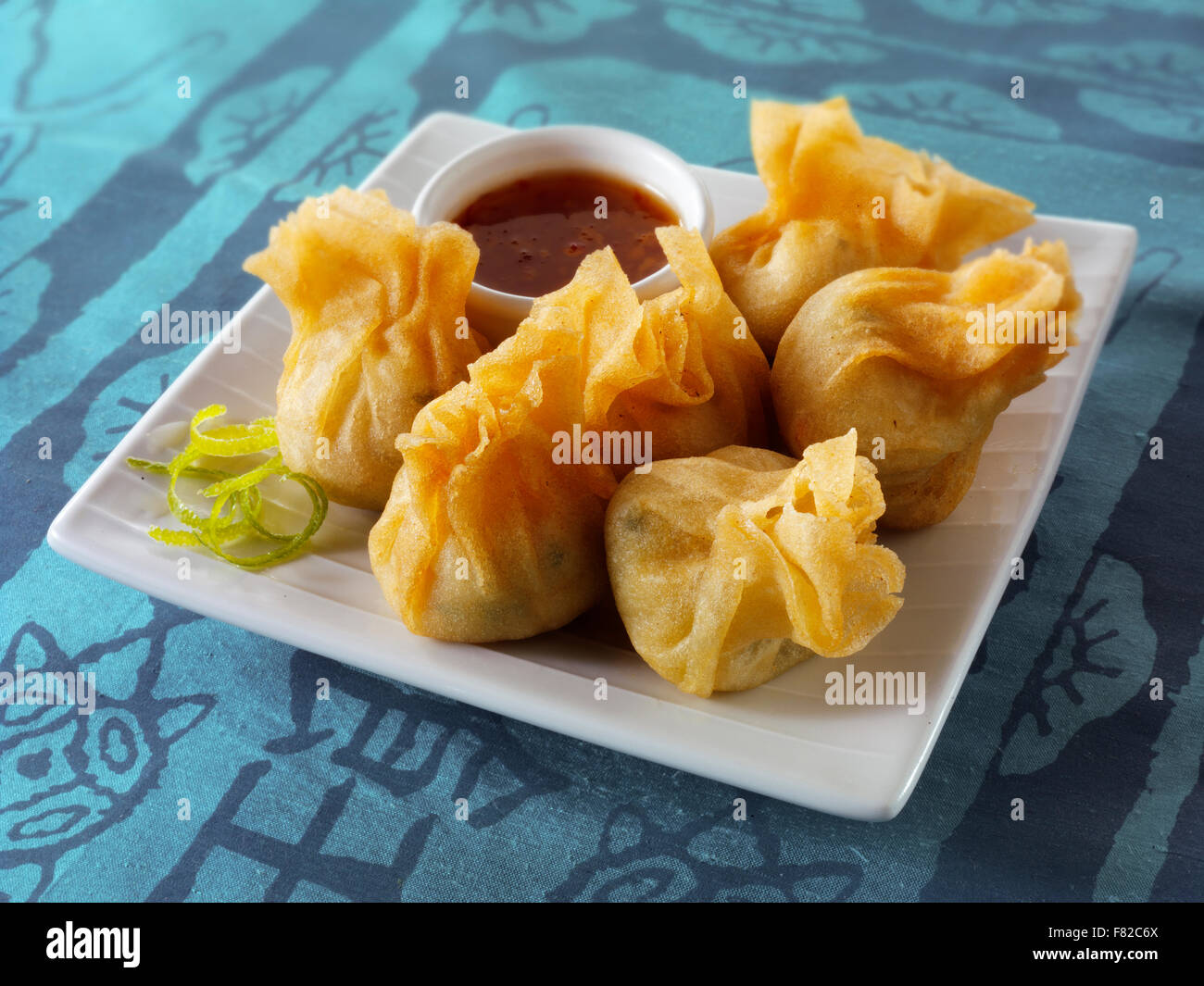 Oriental dim sum with chicken &vegetables with a hoisin dipping sauce - Stock Image