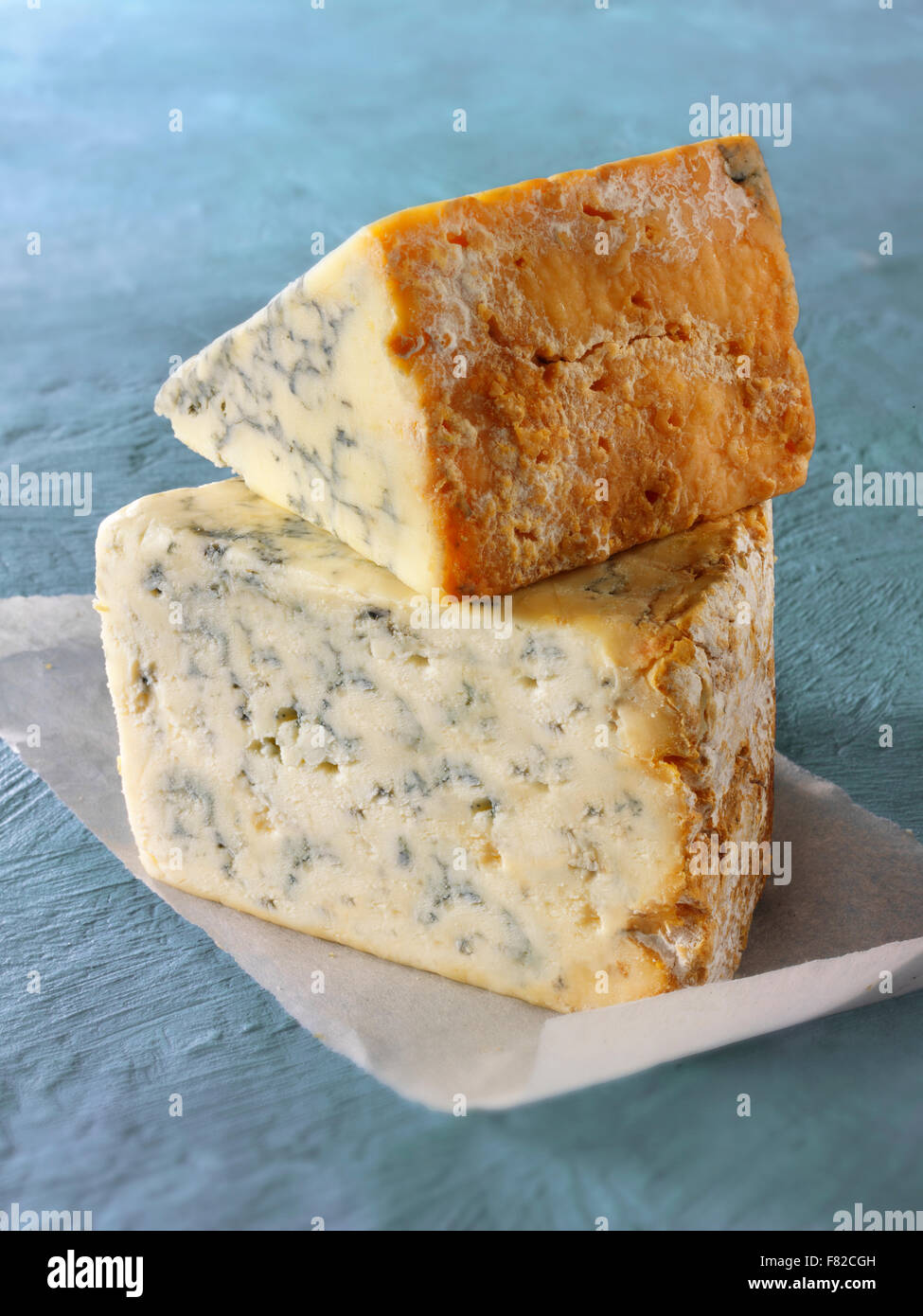 close up of a wedge of blue Cheese - Creamy Stilton ( bottom) Stilton above. - Stock Image