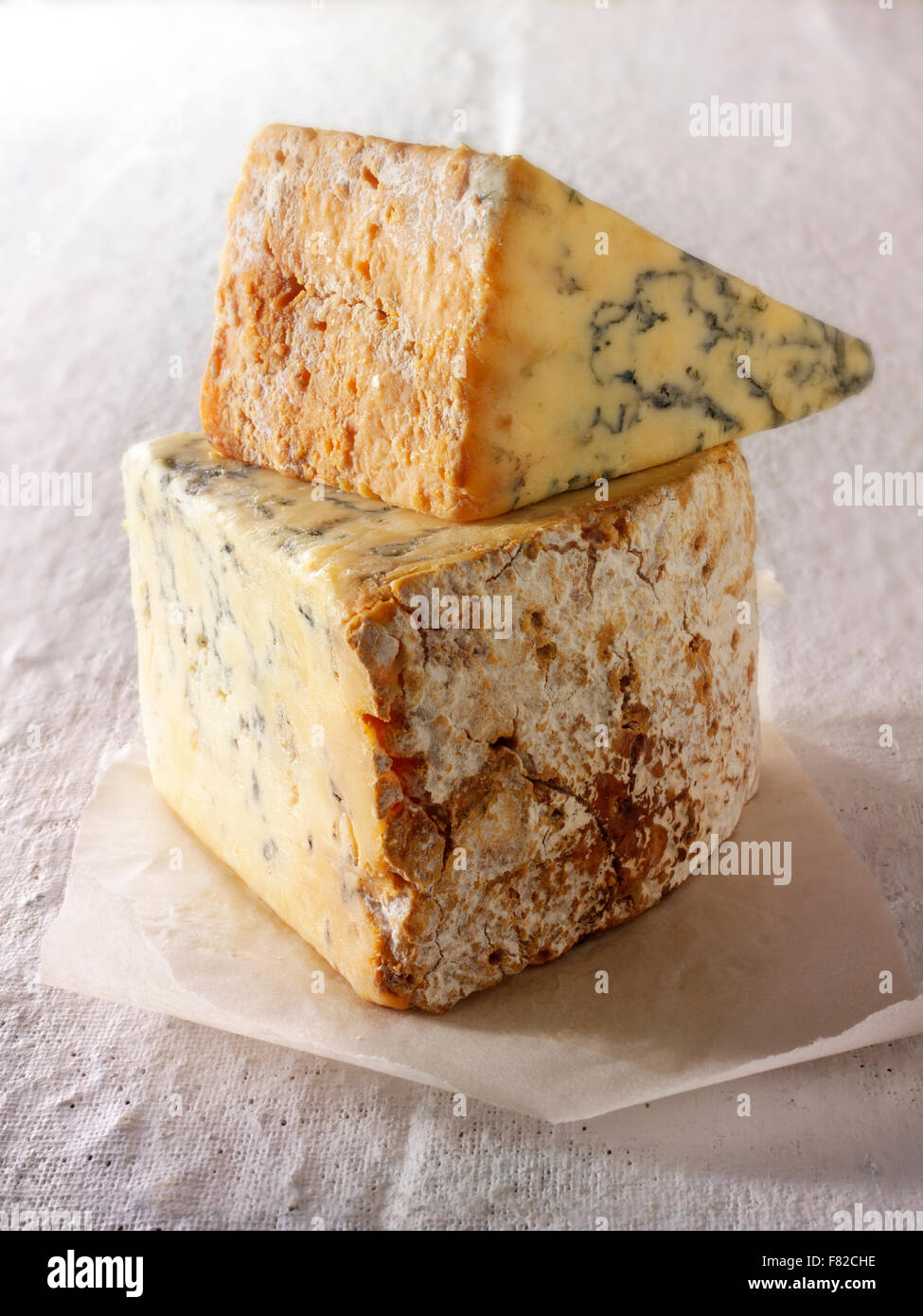 Close up of wedges of blue Stilton cheese - Stock Image