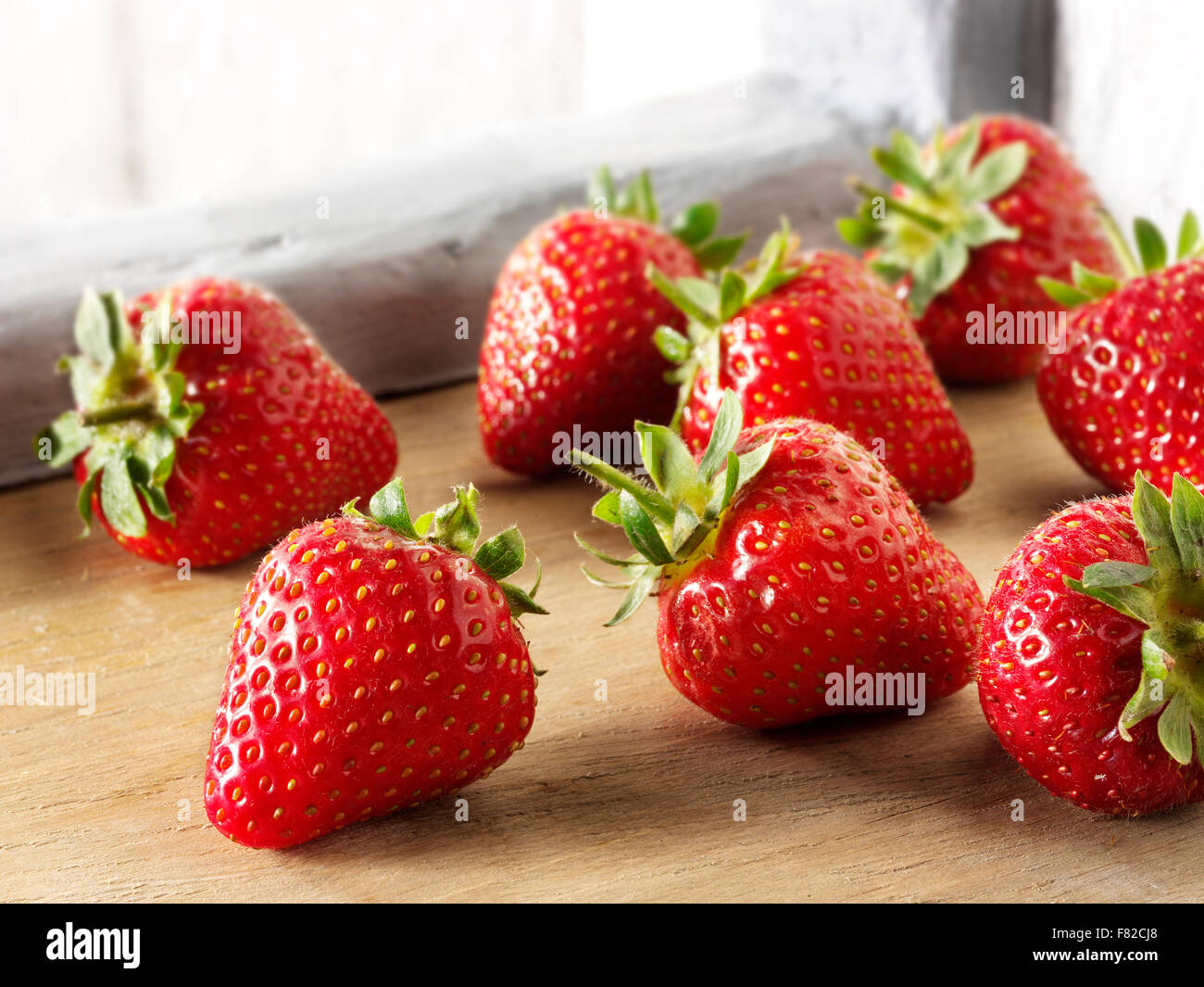 Fresh Strawberry Fruit With Green Hulls In A Kitchen Setting Stock Photo Alamy
