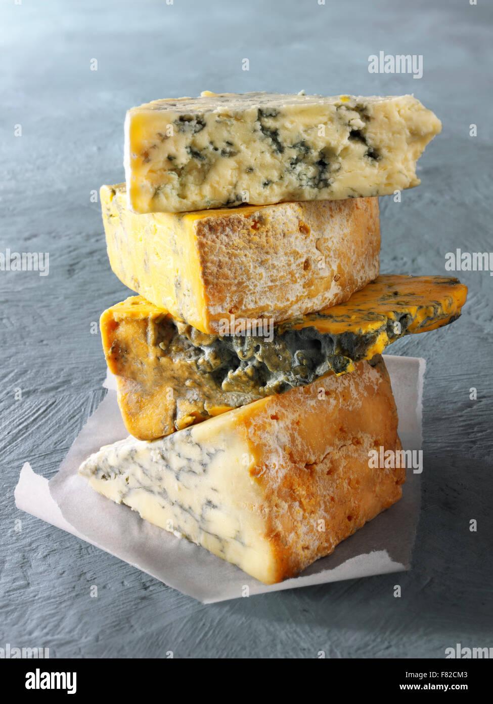 Close up of wedges of blue Cheese - From the top - Blue Vinney, Stilton, Blacksticks Blue, Creamy Stilton - Stock Image