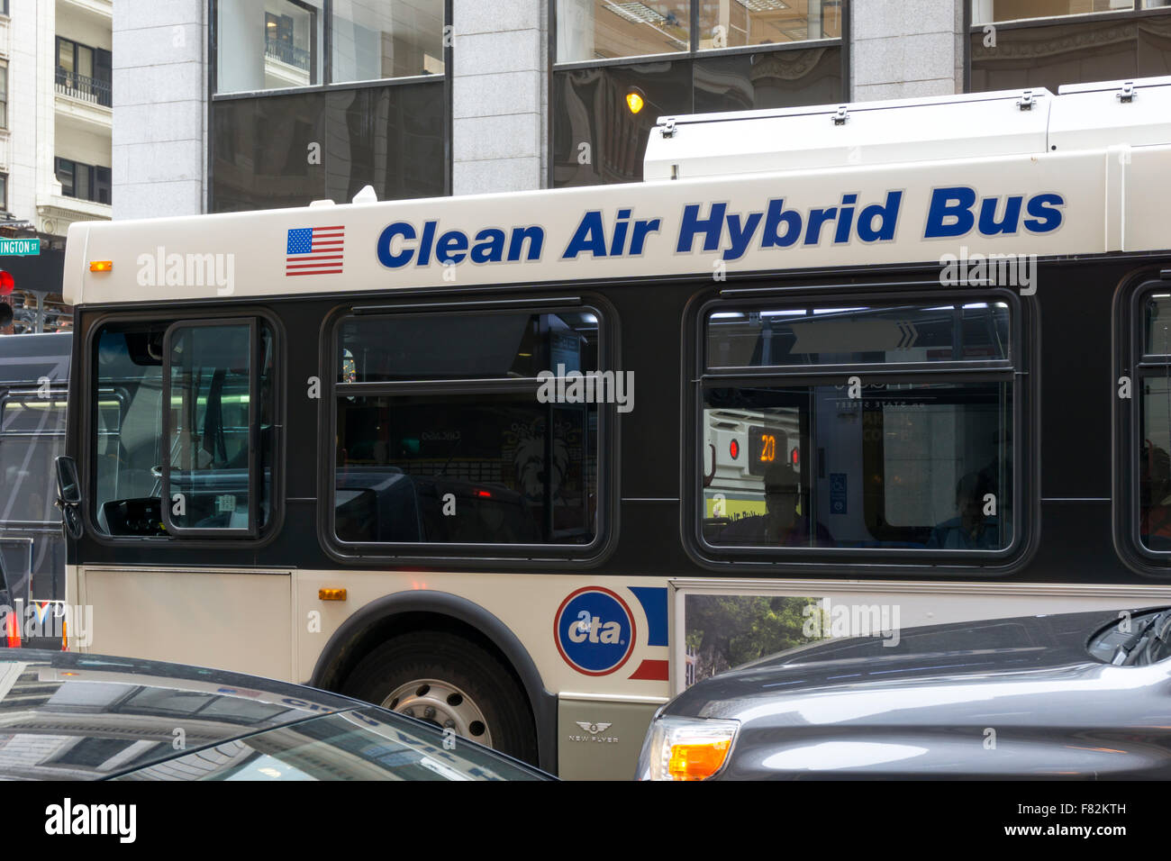 A Chicago Transit Authority Clean Air Hybrid Bus in traffic. - Stock Image