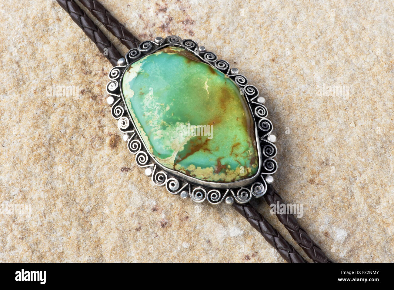 Southwestern green turquoise silver bolo tie. - Stock Image