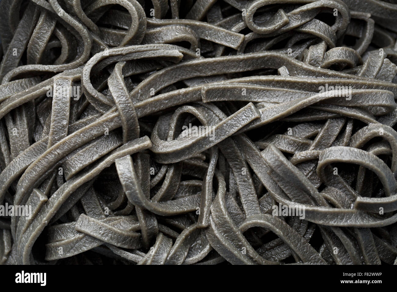 cooked black noodles with squid sepia ink - Stock Image