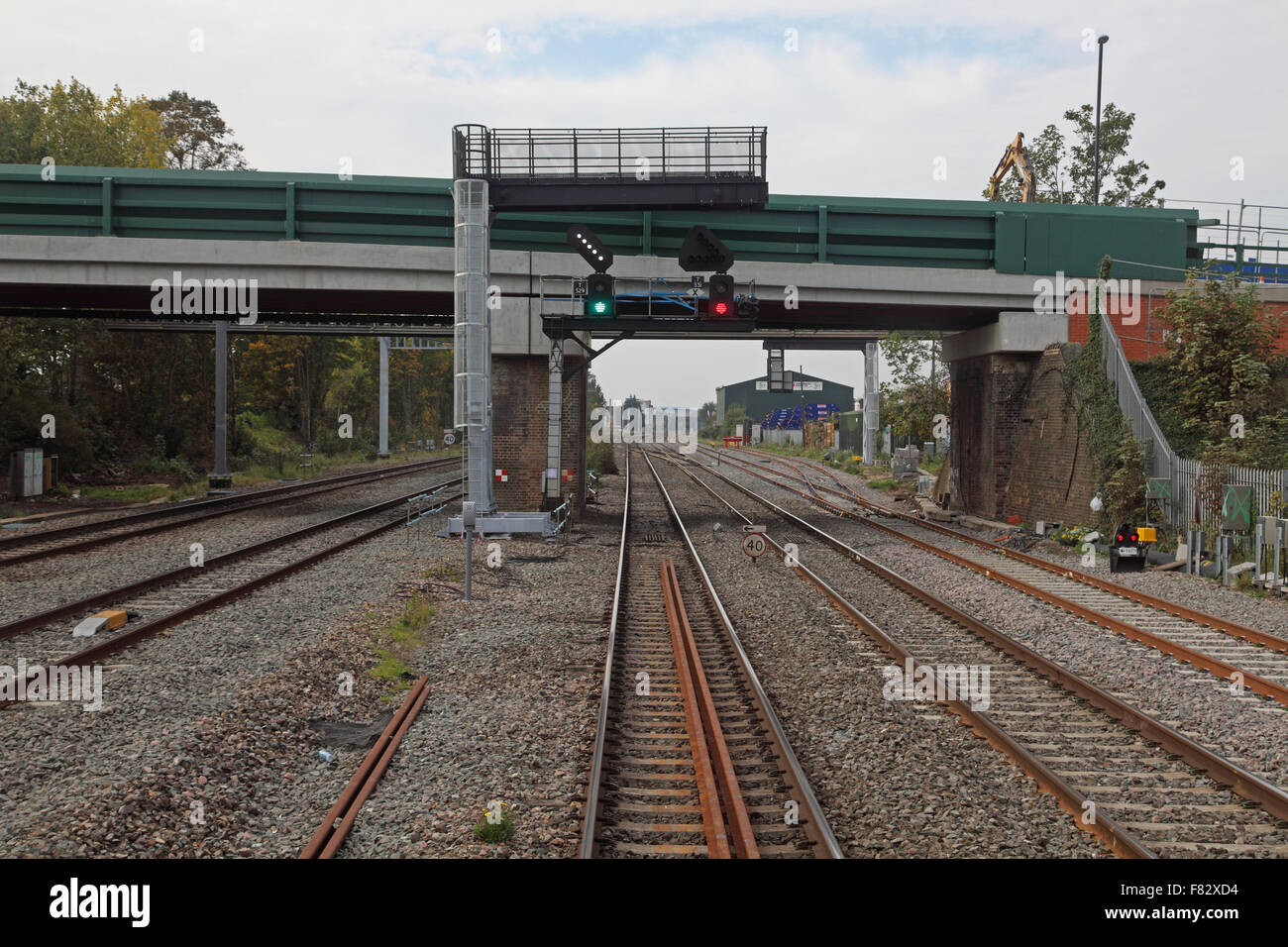 On the relief line stood facing a green signal with a lit junction indicator in front of a newly constructed road - Stock Image