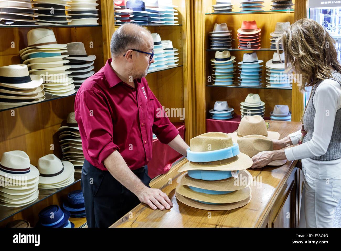 Spain Europe Spanish Hispanic Madrid Centro Plaza Mayor hat shop millinery shelves sale display fedoras Panama fashion - Stock Image