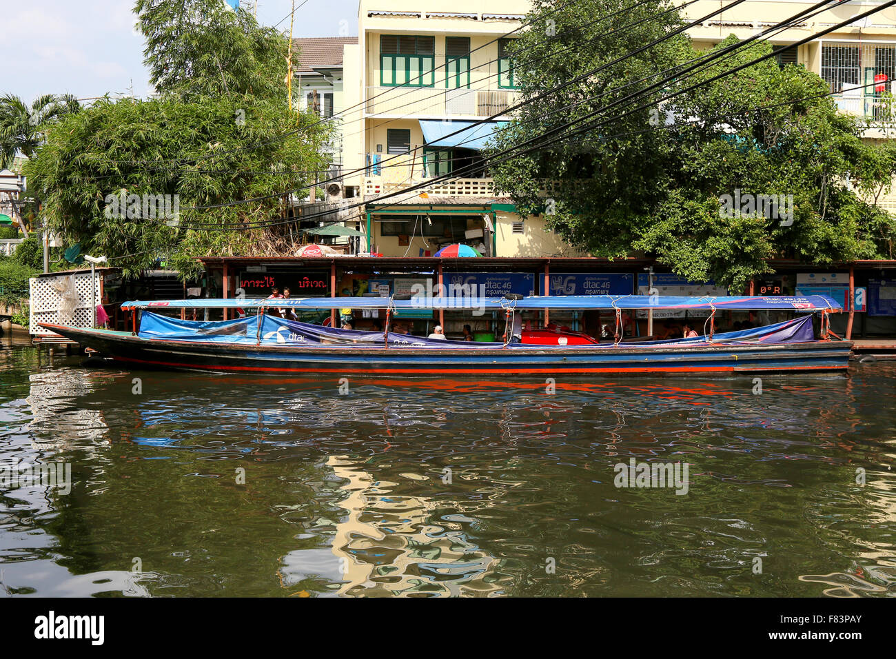 Canal boat in downtown Bangkok. - Stock Image