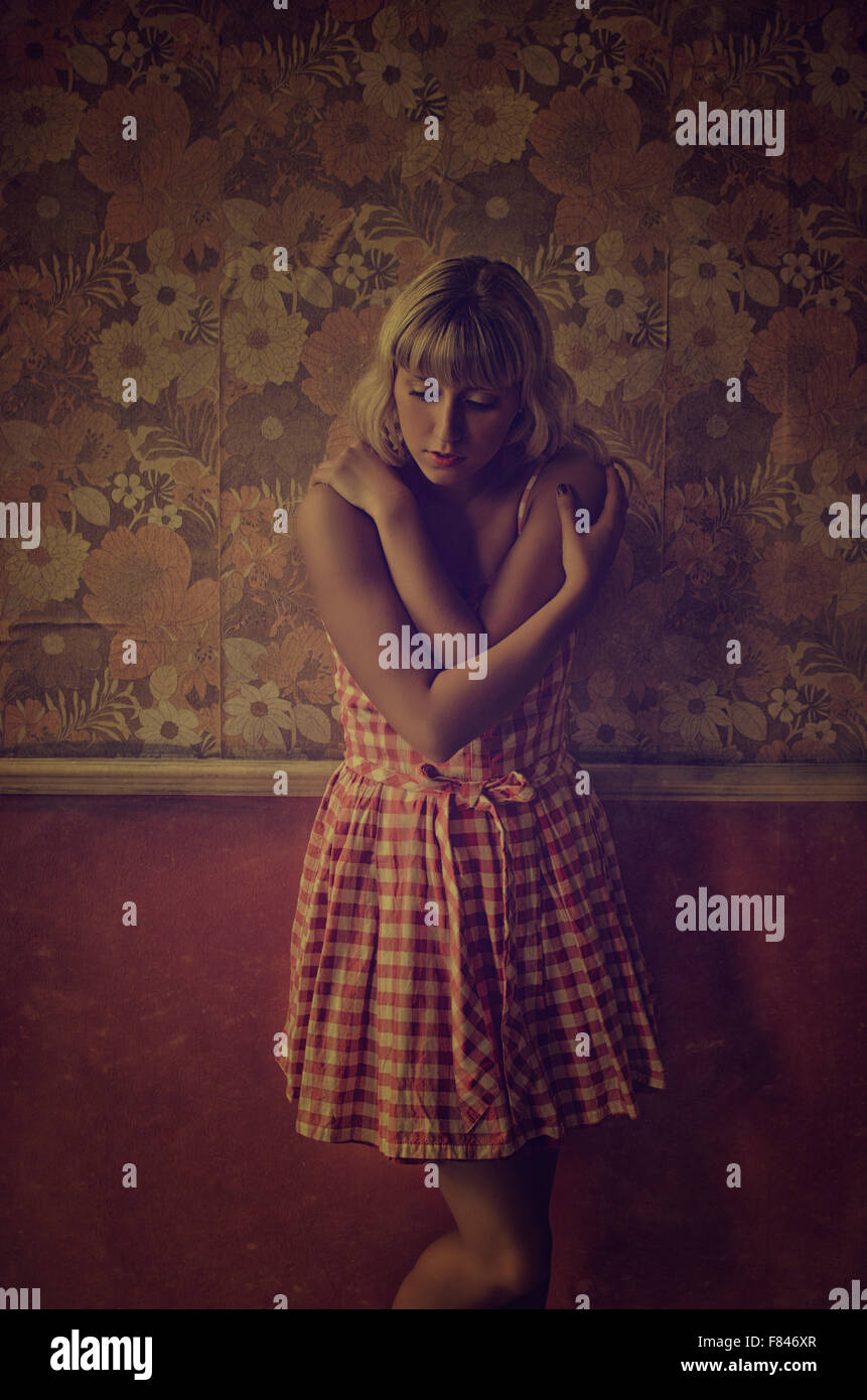 Scared young woman hands on shoulders - Stock Image