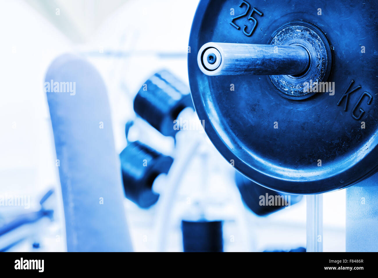 Detail barbell from bench on background of gym - Stock Image