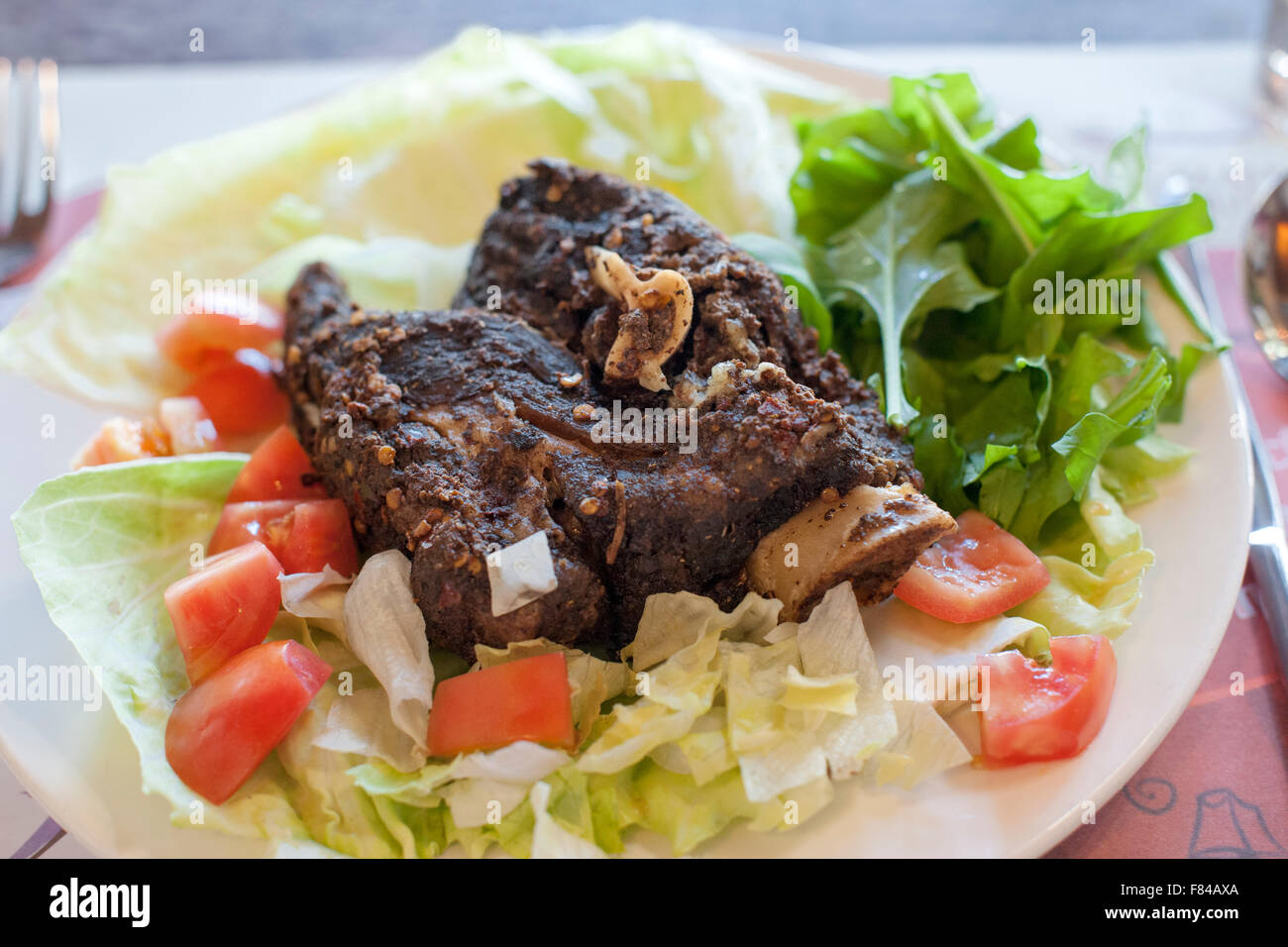 Lamb shewa, a traditional Omani dish as served by the Al Maida restaurant in Muscat, the capital of the Sultanate - Stock Image