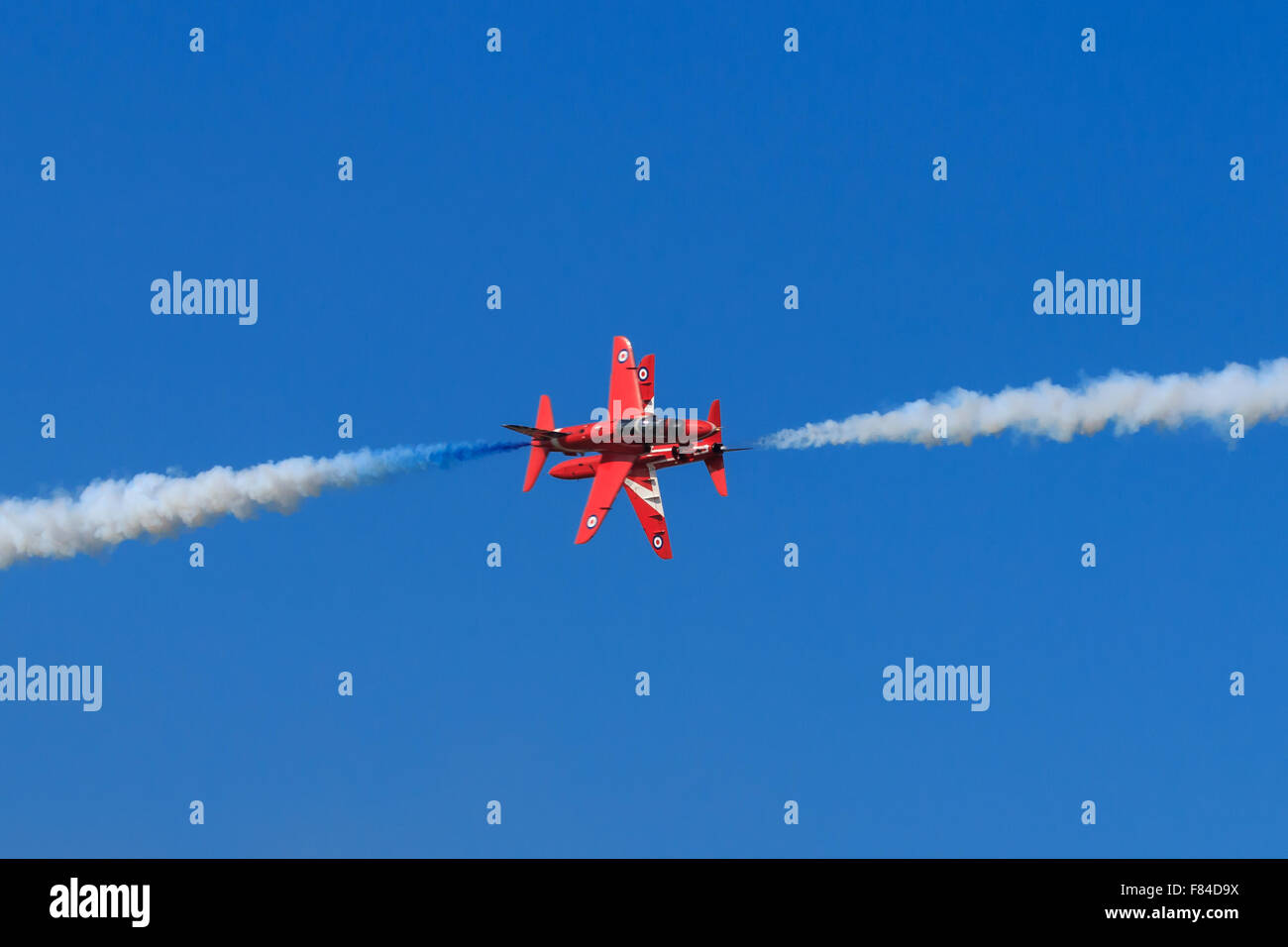 Red Arrows  6 and 7 performing their popular opposition maneuvre at Southport air show 2014. - Stock Image