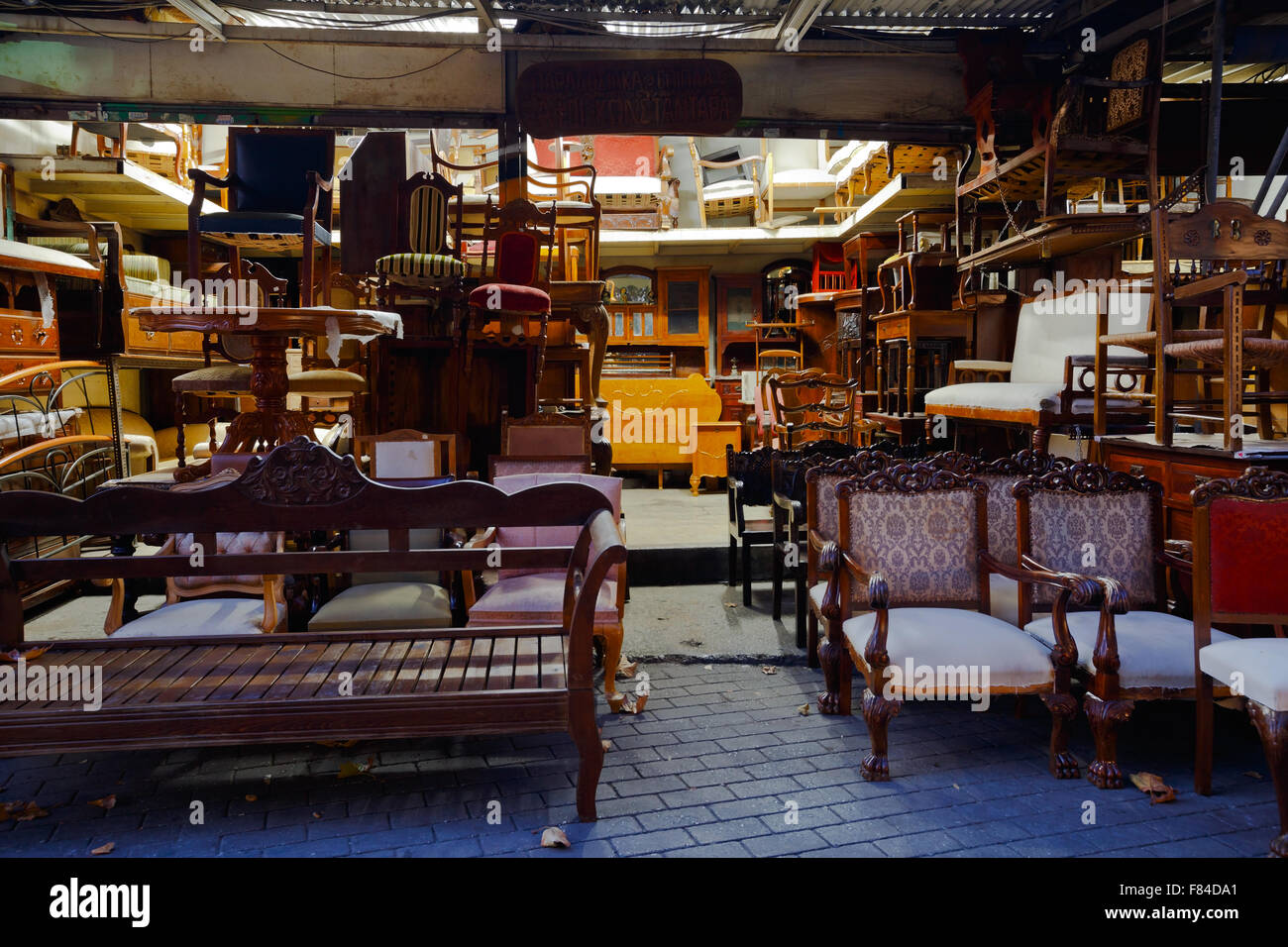 Antique furniture shop in the flea market in the Monastiraki area in Plaka, Athens. - Stock Image