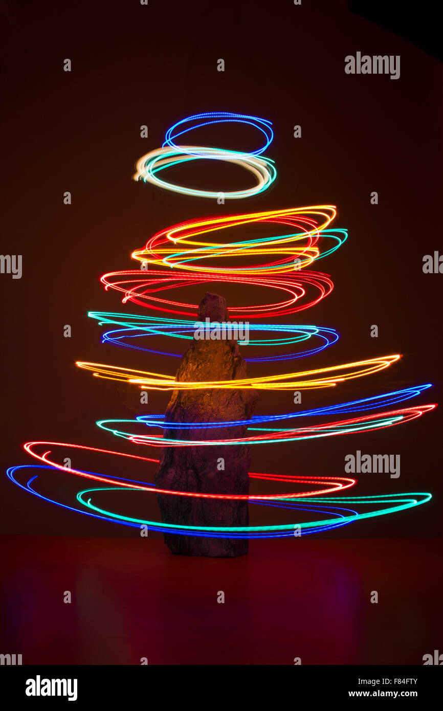 Light painting to create an abstract Christmas tree - Stock Image