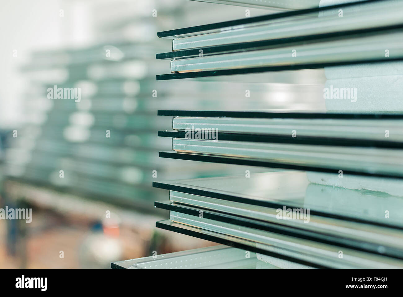 Sheets of Factory manufacturing tempered clear float glass panels cut to size - Stock Image