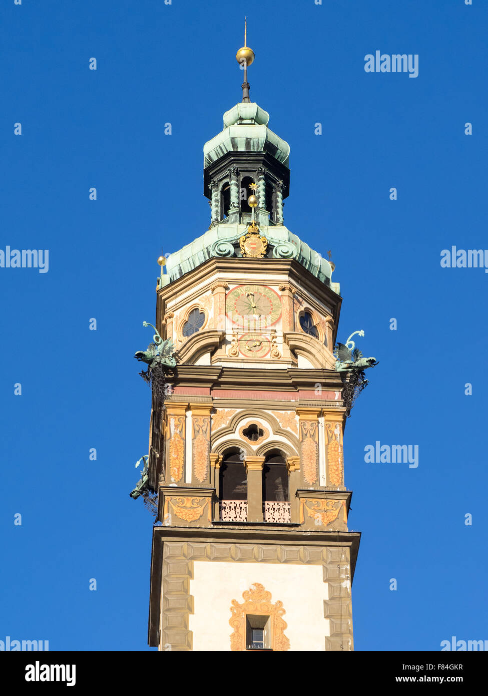 Tower bell of Hearth of Jesus church of Hall in Tirol, near Innsbruck, with blue sky, vertical frame. - Stock Image