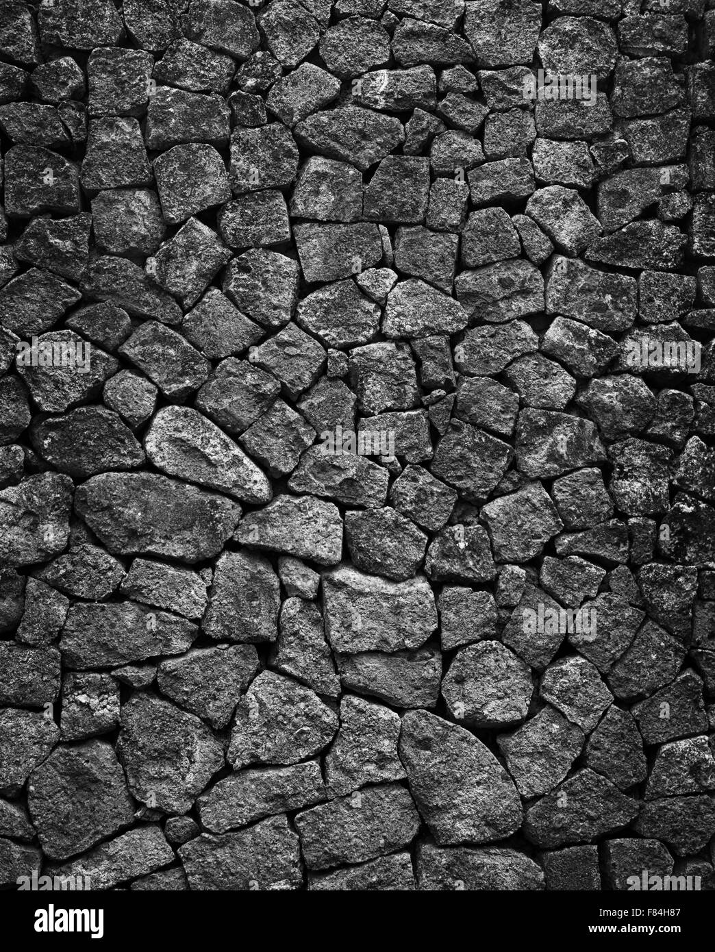 Mosiac hand crafted gray solid granite stone wall background. - Stock Image
