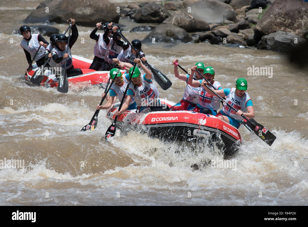 Master women's teams of Norway and New Zealand compete in head to head sprint race category on on World Rafting - Stock Image