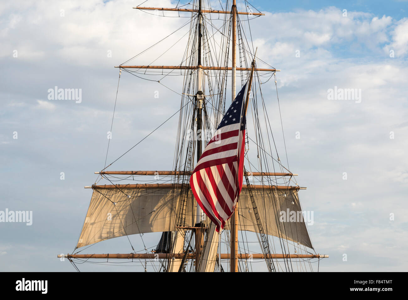 Large sized American Flag with boat mast and rigging. - Stock Image