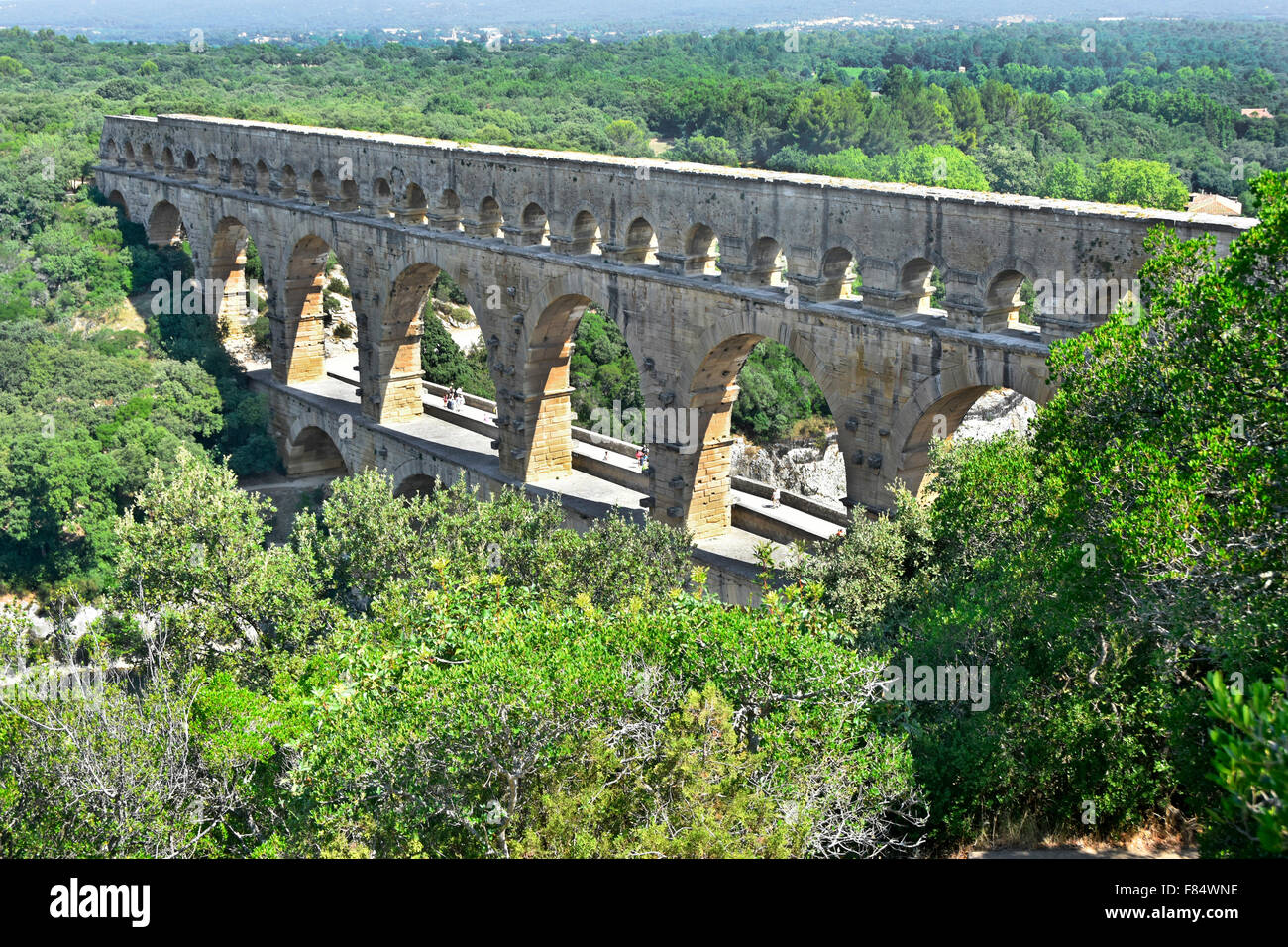 Pont du Gard ancient Roman aqueduct spanning the Gardon River with the adjacent road added alongside Stock Photo