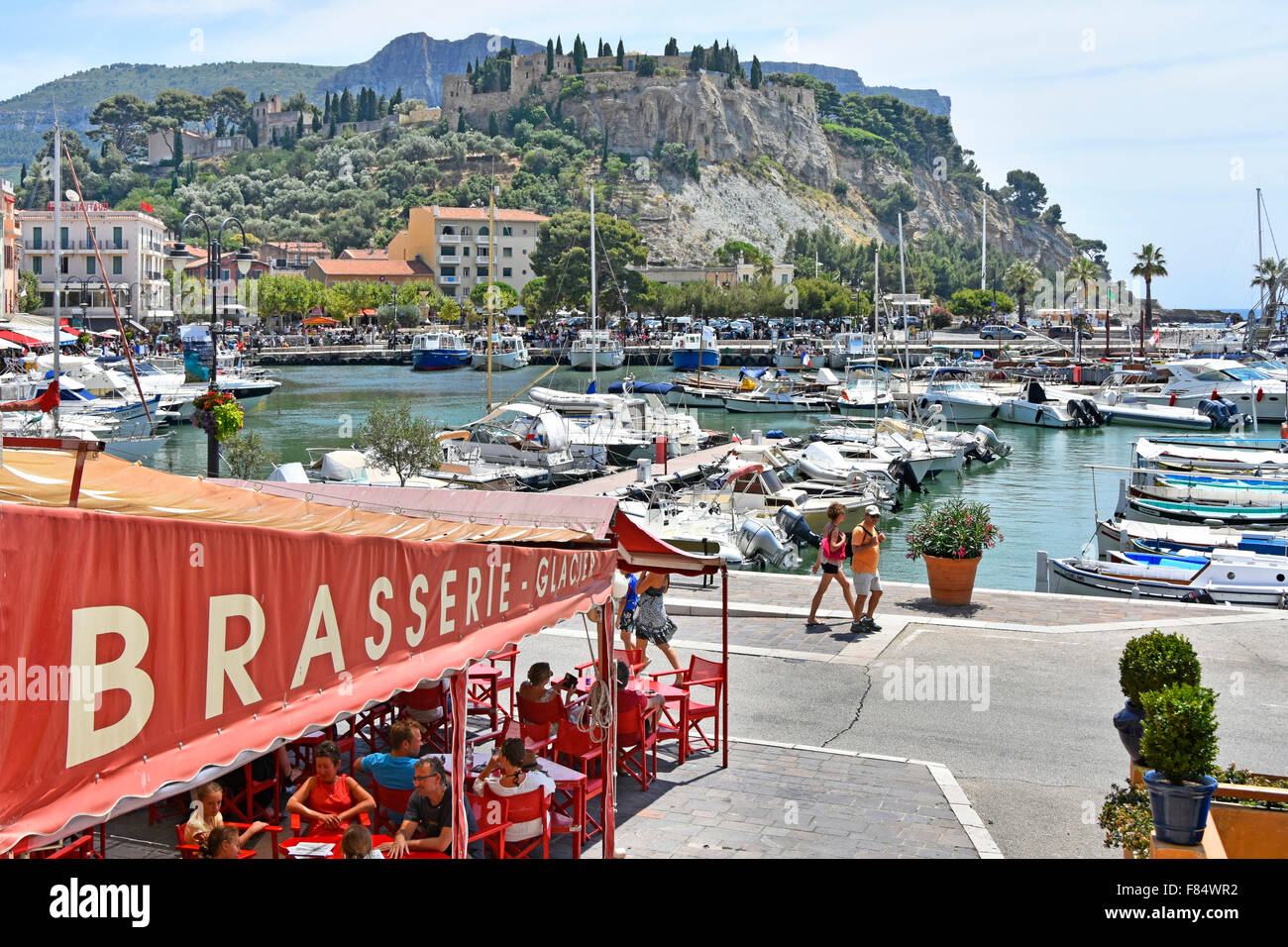 Cassis France Provence Brasserie restaurant canopy harbour waterfront converted cliff top castle Chateau De Cassis - Stock Image
