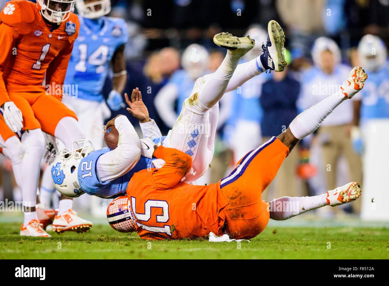 UNC quarterback Marquise Williams (12) is sacked by Clemson safety T.J.  Green (15) during the ACC College Football Championship game between North  Carolina and Clemson on Saturday Dec. 5, 2015 at Bank