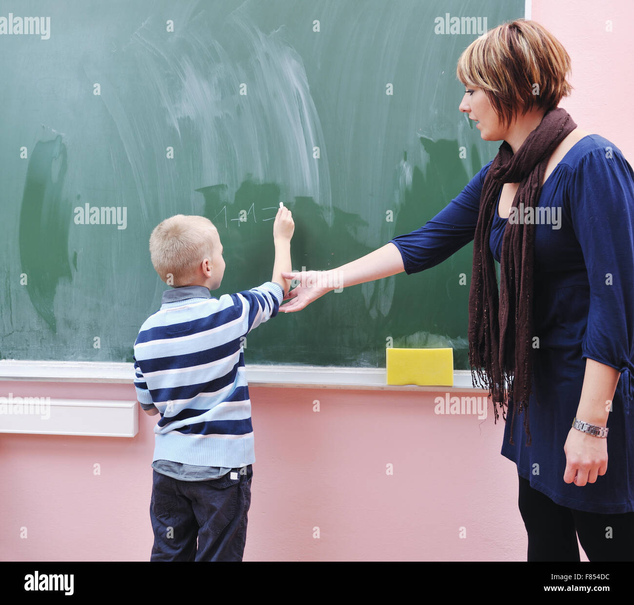 happy young boy at first grade math classes solving problems and ...