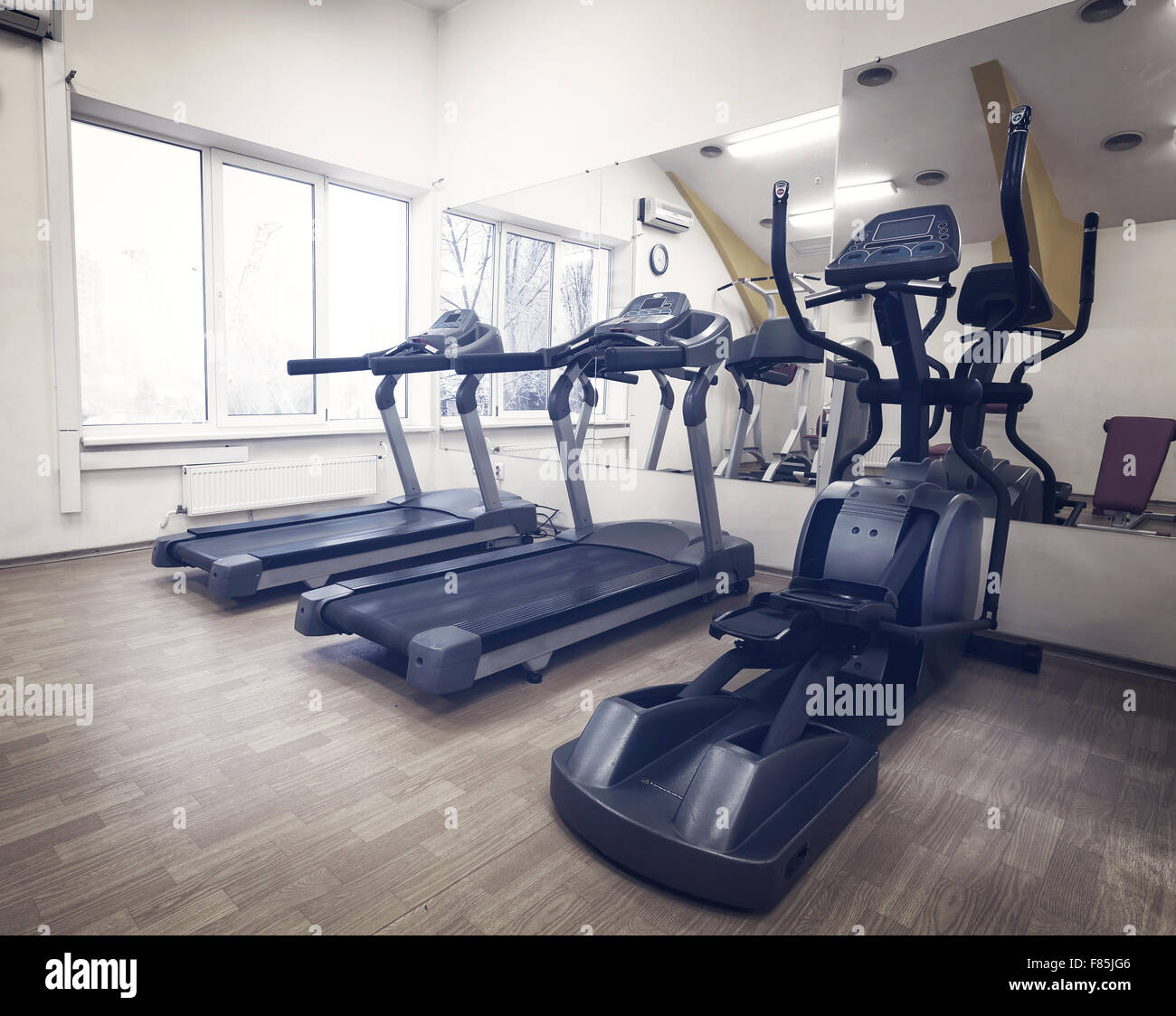 Cardio in the gym against the window - Stock Image