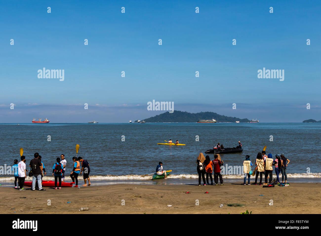 Likas Bay Kota Kinabalu Sabah East Malaysia Borneo people on beach boating in South China Sea - Stock Image