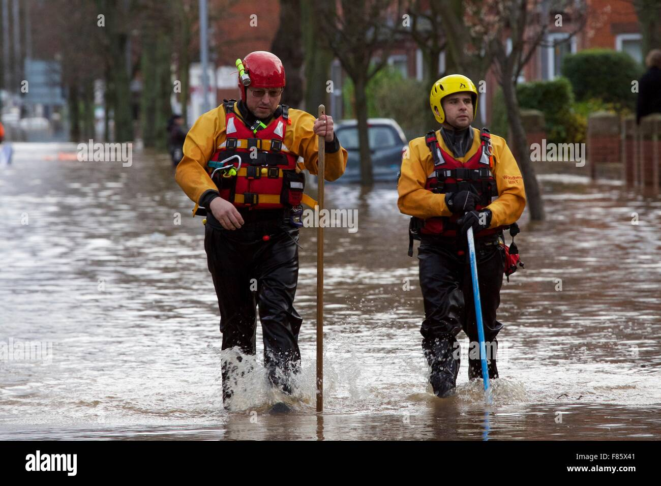 Cumbria Floods. 6th December 2015. RNLI rescue team volunteer wading through Carlisle city centre. Storm Desmond - Stock Image