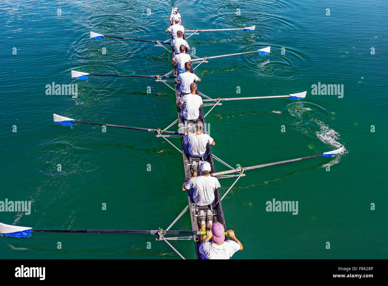 Boat coxed eight Rowers training rowing on the lake - Stock Image