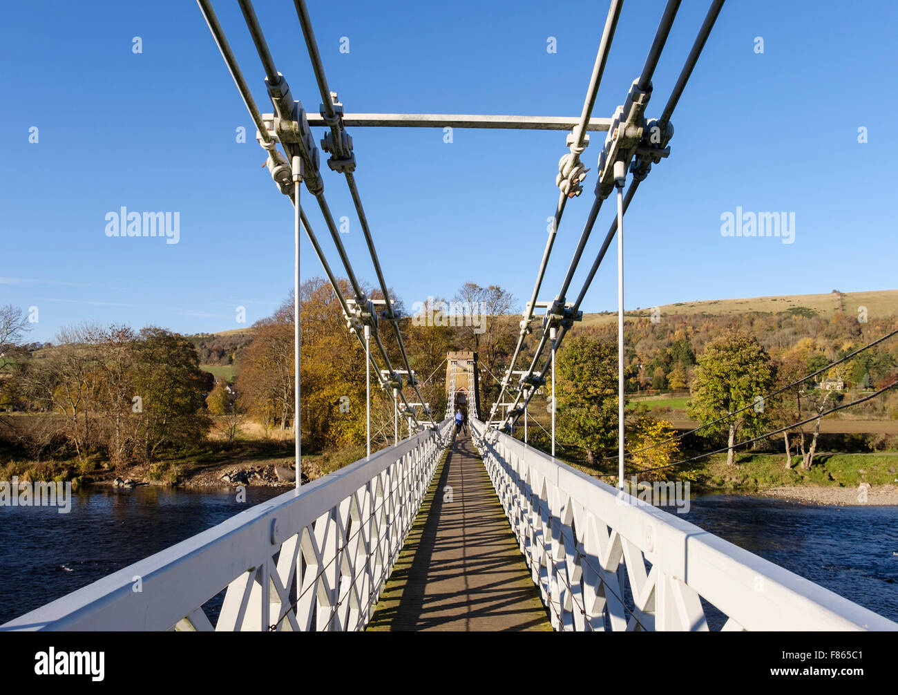 Looking along Chainbridge footbridge route of Southern Upland Way across River Tweed. Melrose Scottish Borders Scotland - Stock Image