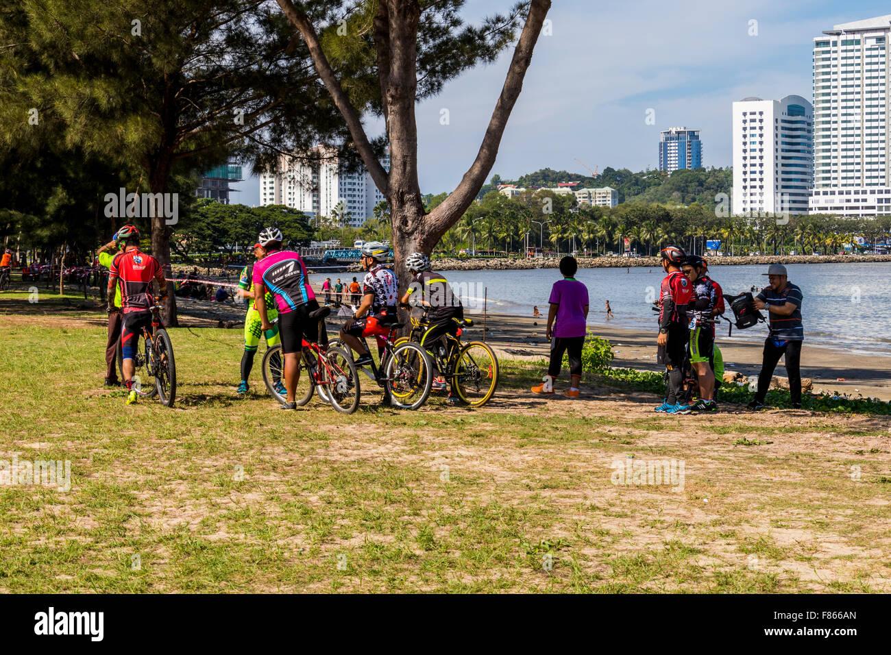 Cyclist enjoying day out at Likas Bay in Kota Kinabalu Sabah East Malaysia on Island of Borneo - Stock Image