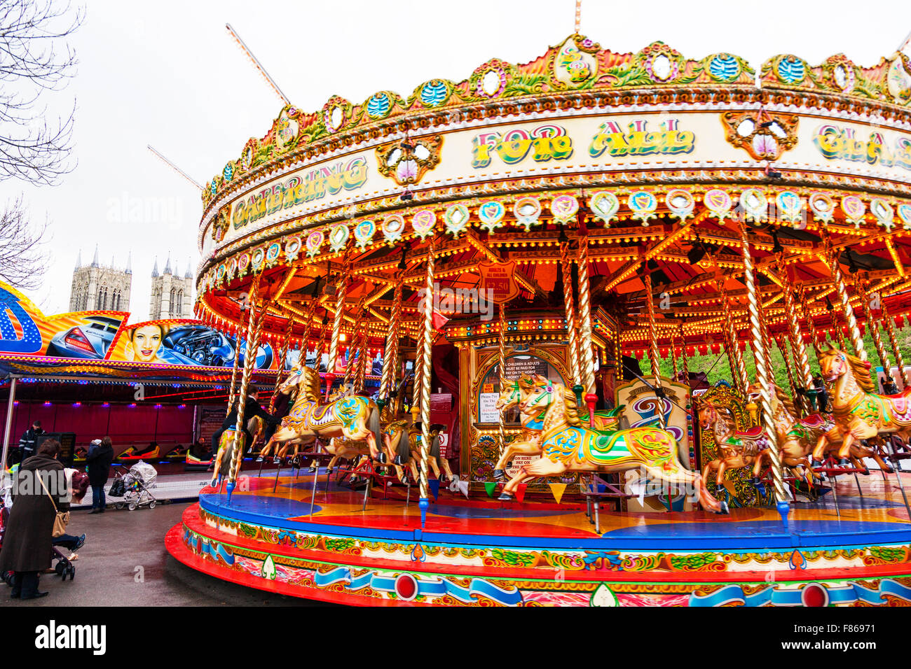 Merry go round fair ride merry-go-round funfair children's rides fun enjoyment Lincoln Christmas Market Lincolnshire Stock Photo
