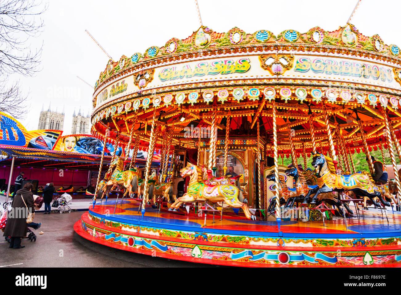Merry go round fair ride merry-go-round funfair children's rides fun enjoyment Lincoln Christmas Market 06/12/2015 Stock Photo