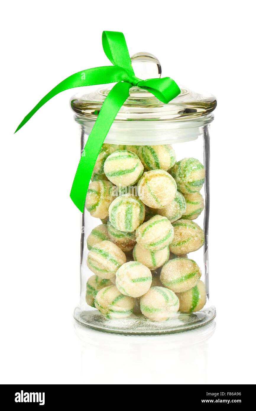 Photograph of a beautiful jar full of colorful candies, on a white background - Stock Image