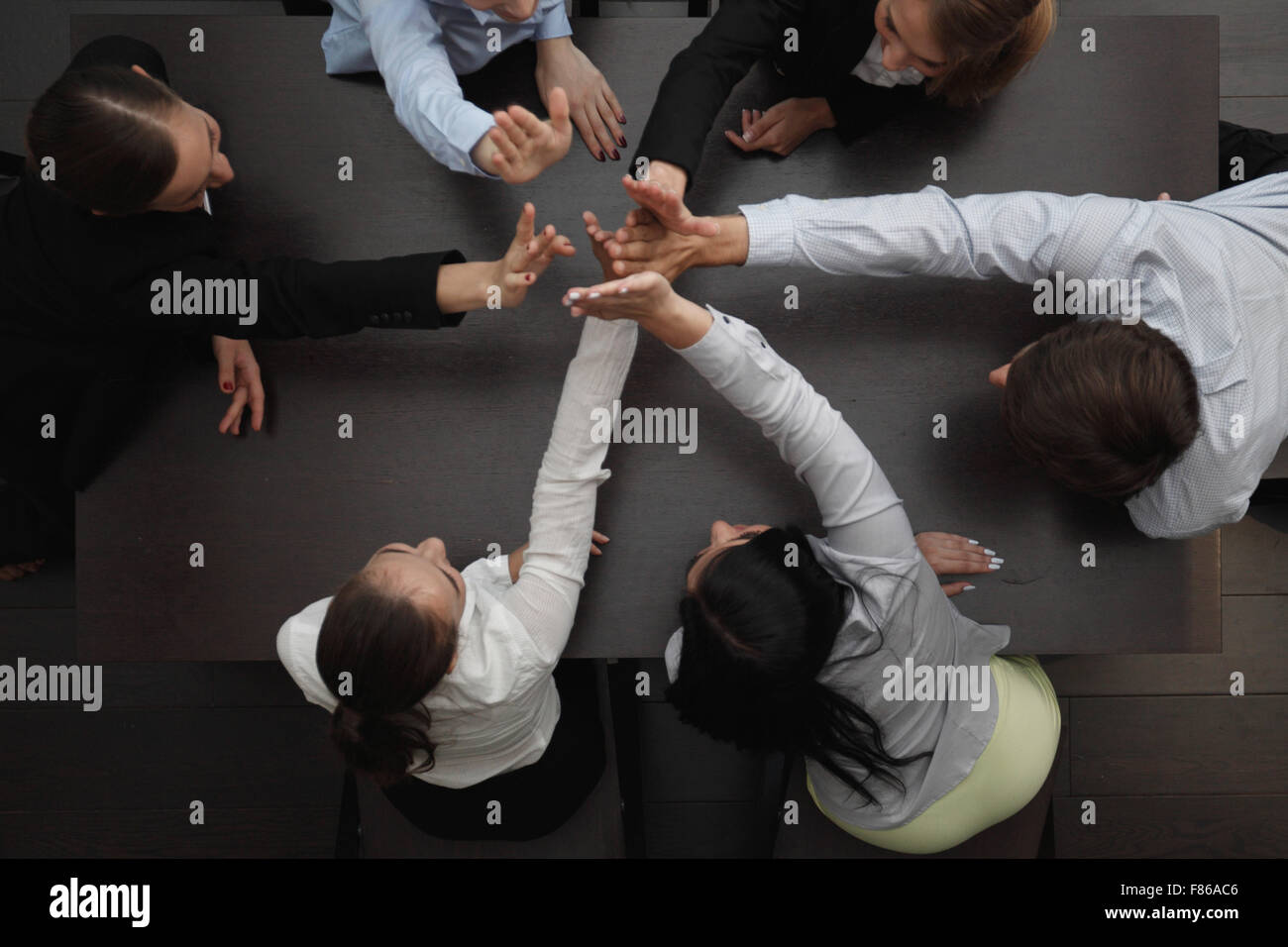 People with their hands together. Business team work concept - Stock Image